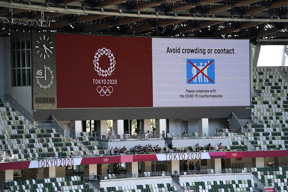 Covid-19 related warnings on the big screen ahead of the opening ceremony of the Tokyo 2020 Olympic Games at the Olympic Stadium in Japan. Picture date: Friday July 23, 2021. (Photo by Mike Egerton/PA Images via Getty Images)