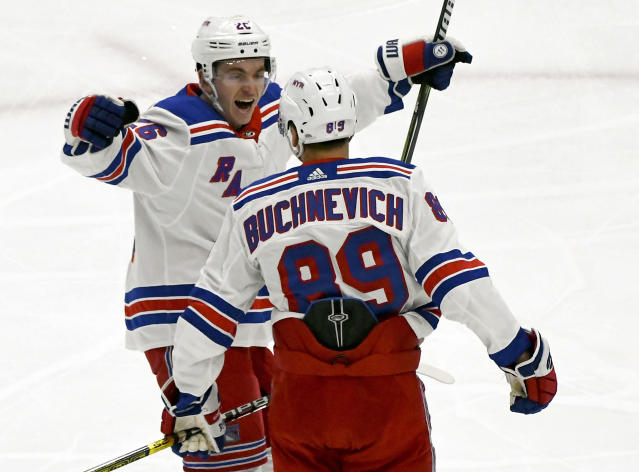 New York Rangers left wing Jimmy Vesey (26) hugs right wing Pavel Buchnevich (89) after Buchnevich scored a goal against the Chicago Blackhawks during the first period of an NHL hockey game, Thursday Oct. 25, 2018, in Chicago. (AP Photo/Matt Marton)