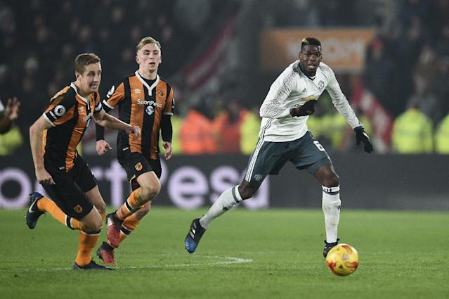 Manchester United's Paul Pogba (R) makes a break against Hull in their League Cup semi-final second-leg (AFP Photo/Oli SCARFF )