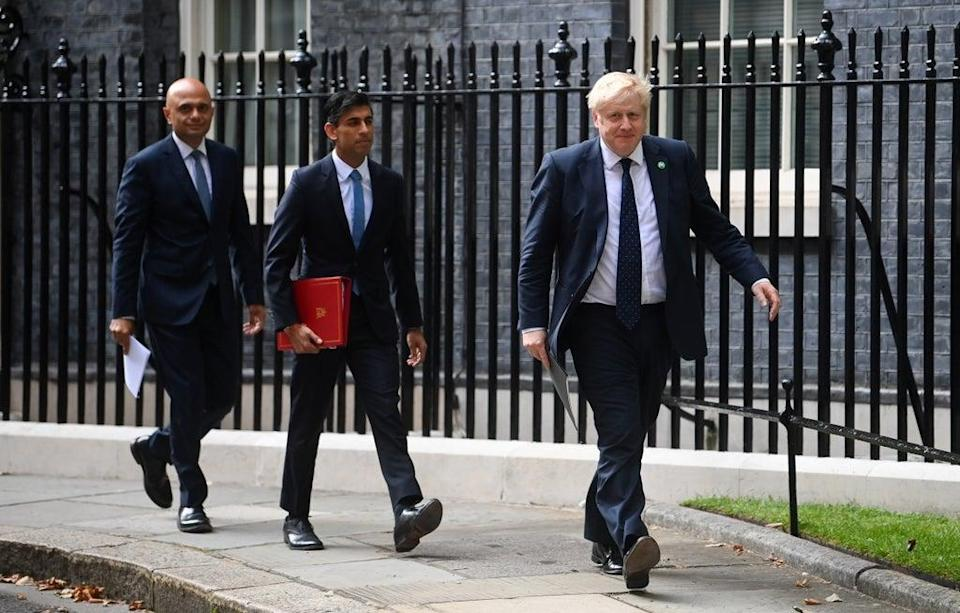 Health Secretary Sajid Javid, Chancellor of the Exchequer Rishi Sunak and Prime Minister Boris Johnson arriving at No 9 Downing Street for a media briefing on the long-awaited plan to fix the broken social care system. (Toby Melville/PA) (PA Wire)