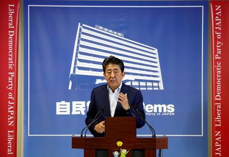 Japan's Prime Minister Shinzo Abe, who is also leader of the Liberal Democratic Party, attends a news conference a day after an upper house election at LDP headquarters in Tokyo