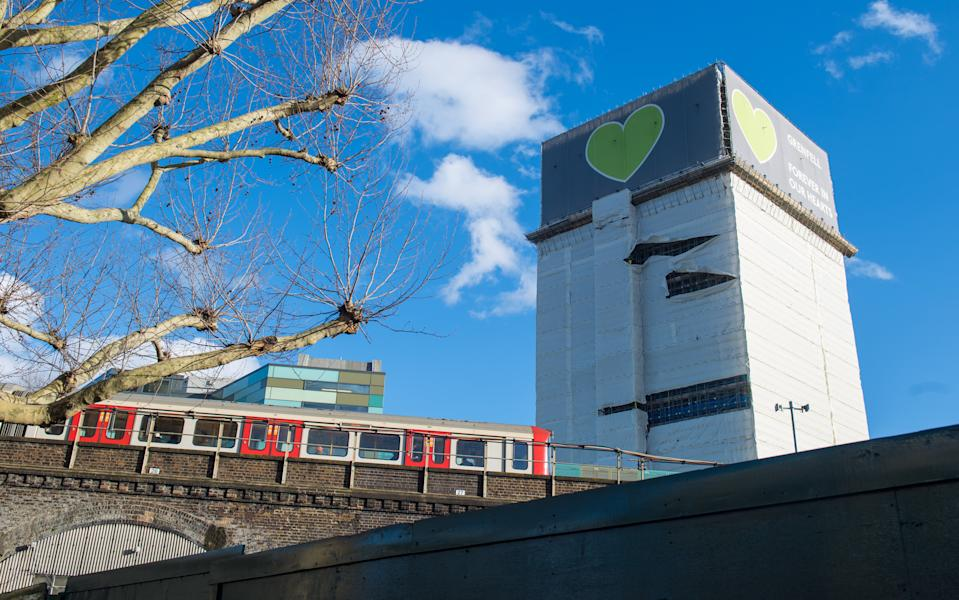 Grenfell Tower, in west London, after high winds damaged plastic sheeting covering the building. (Photo by Dominic Lipinski/PA Images via Getty Images)