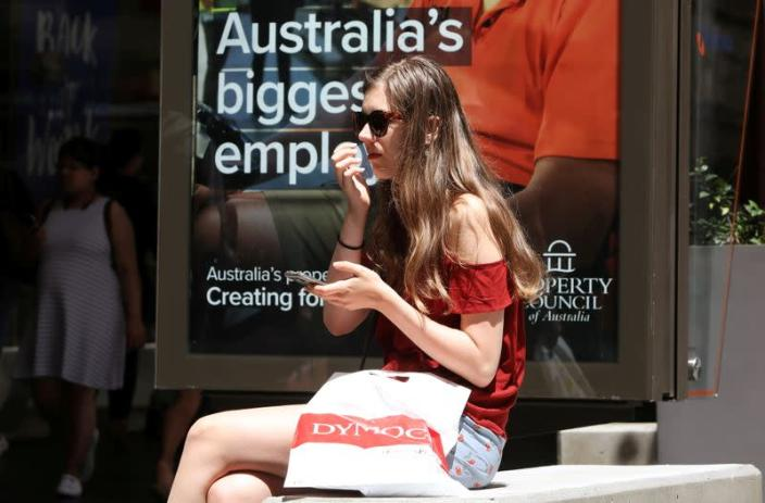FILE PHOTO: A woman with a shopping bag takes a rest at Pitt Steet Mall in Sydney