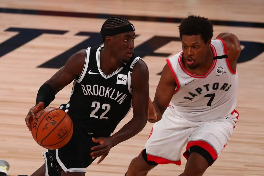 Caris LeVert drives to the basket against Kyle Lowry