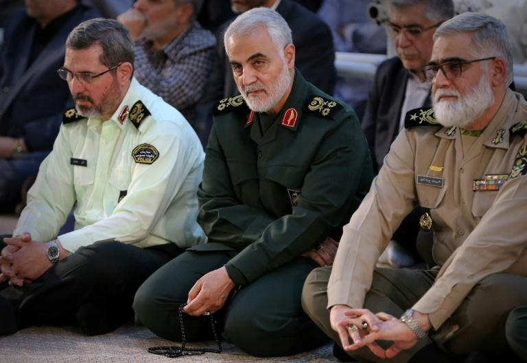 Iranian Major General in the Islamic Revolutionary Guard Corps (IRGC) Qasem Soleimani (C) is on a UN sanctions blacklist that the United States says must be updated to be properly enforced
