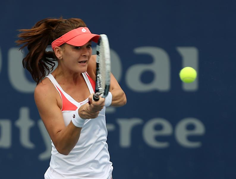 Agnieszka Radwanska of Poland returns to Yulia Putinseva of Kazakhstan during the third day of Dubai Duty Free Tennis Championships in Dubai, United Arab Emirates, Wednesday, Feb. 20, 2013. (AP Photo/Regi Varghese)