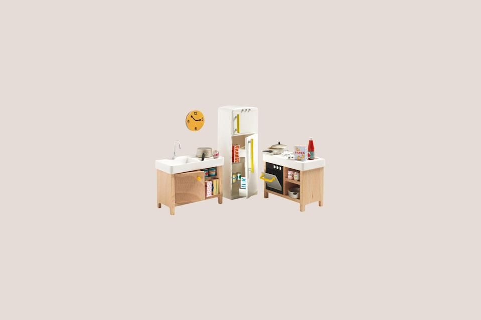 "<p>Dreaming of making a miniature scene with tiny cooking appliances and cookware? This delightful tiny kitchenette kit boasts a sink, oven, and mini refrigerator stocked with juices, condiments, and soda cans.</p> <p><strong><em>Shop Now:</em></strong> <em>Djeco ""The Kitchen"", $34, </em><a href=""https://en.smallable.com/the-kitchen-djeco-30356.html"" rel=""nofollow noopener"" target=""_blank"" data-ylk=""slk:en.smallable.com"" class=""link rapid-noclick-resp""><em>en.smallable.com</em></a><em>. </em></p>"