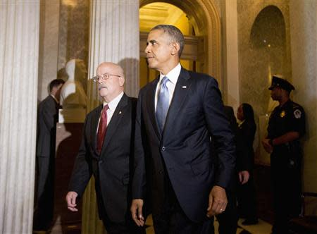 U.S. President Barack Obama walks between meetings on Syria, on Capitol Hill in Washington