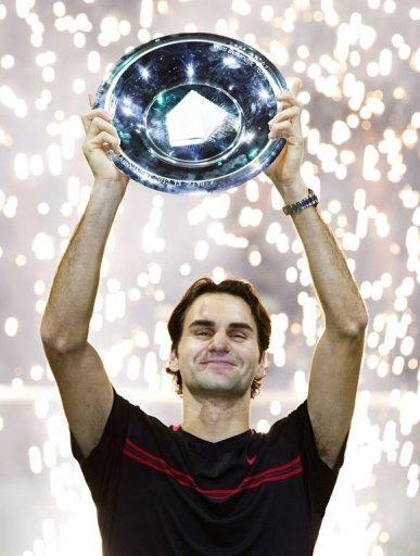 Switzerland's Roger Federer holds the trophy after winning the ABN AMRO Tennis Tournament in Rotterdam. Federer won the final 6-1, 6-4 against Juan Martin de Potro of Argentina