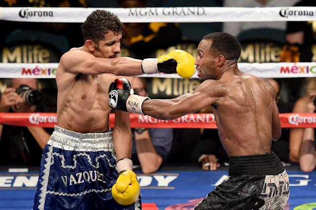 Miguel Vazquez throws a right to the face of Mickey Bey during their IBF lightweight title fight at the MGM Grand Garden Arena on September 13, 2014 in Las Vegas, Nevada (AFP Photo/Ethan Miller)