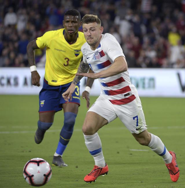 United States midfielder Paul Arriola (7) chases after a ball in front of Ecuador defender Robert Arboleda (3) during the first half of an international friendly soccer match Thursday, March 21, 2019, in Orlando, Fla. (AP Photo/Phelan M. Ebenhack)