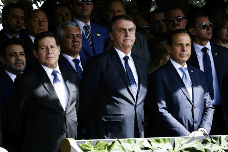 The President of the Republic, Jair Bolsonaro (PSL), on July 3, 2019 in Sao Paulo, Brazil, of the solemnity of passage of the Southeastern Military Command, from General Luiz Eduardo Ramos Baptista Pereira to General Marcos Antonio Amaro dos Santos. The governor of the State of São Paulo, João Doria (PSDB) also attended the event. In the photo, the Vice President of the Republic, General Mourão, President Jair Bolsonaro and the governor of the State of São Paulo, João Doria. (Photo: Aloisio Mauricio/Fotoarena/Sipa USA)(Sipa via AP Images)