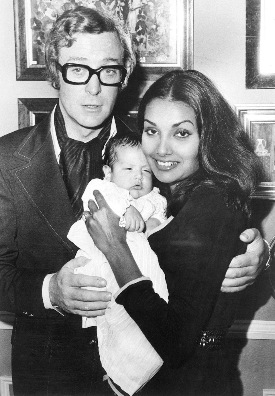 <p>Michael Caine poses with his wife, Shakira, and their newborn daughter, Natasha, at their London home in 1972. </p>