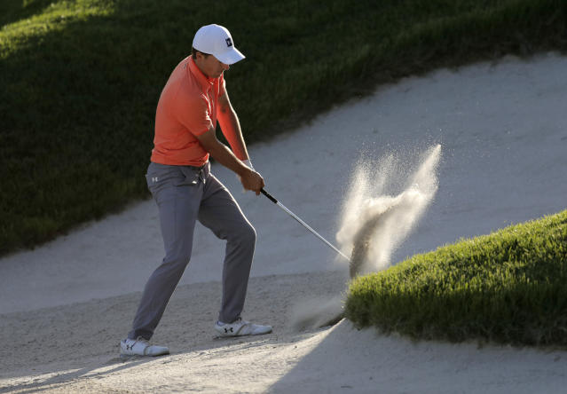 Jordan Spieth hits out of a bunker on the 15th hole during the third round of the PGA Championship golf tournament, Saturday, May 18, 2019, at Bethpage Black in Farmingdale, N.Y. (AP Photo/Julio Cortez)