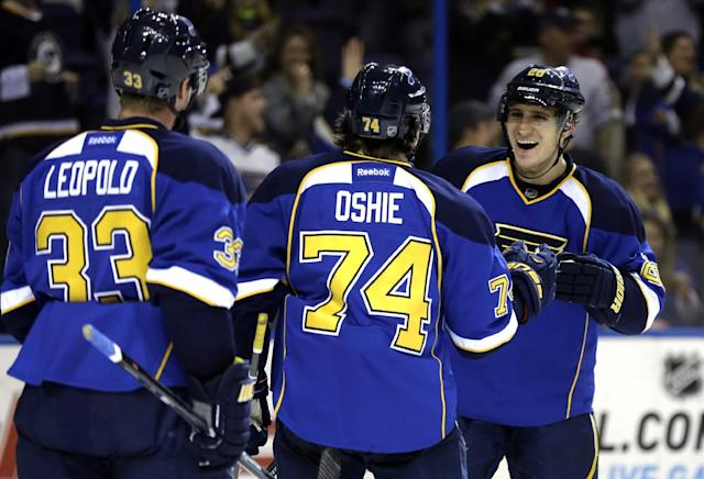 St. Louis Blues' Alexander Steen, right, is congratulated by teammates Jordan Leopold, left, and T.J. Oshie after scoring during the second period of an NHL hockey game against the Calgary Flames on Thursday, Nov. 7, 2013, in St. Louis. (AP Photo/Jeff Roberson)