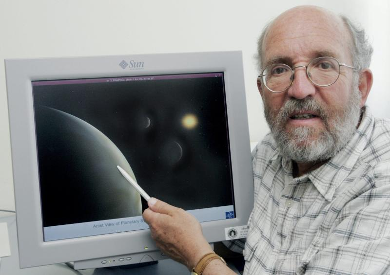"""FILE - Wednesday, May 17, 2006 file photo of Swiss professor Michel Mayor, astrophysicist and director of the Geneva Observatory. The 2019 Nobel prize for Physics was given to James Peebles """"for theoretical discoveries in physical cosmology,"""" and the other half jointly to Michel Mayor and Didier Queloz """"for the discovery of an exoplanet orbiting a solar-type star,"""" said Prof. Goran Hansson, secretary-general of the Royal Swedish Academy of Sciences that chooses the laureates. (Salvatore Di Nolfi, Keystone via AP)"""