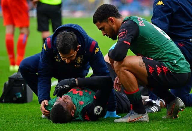 Aston Villa's Wesley receives treatment after the injury during the match at Burnley (Anthony Devlin, PA)