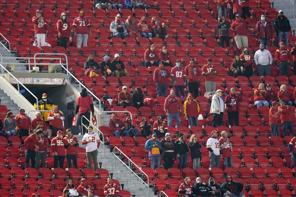 FILE- In this Thursday, Sept. 10, 2020, file photo, fans watch during the first half of an NFL football game between the Kansas City Chiefs and the Houston Texans in Kansas City, Mo. Ten fans who attended the Chiefs game last week have been told to quarantine after one fan tested positive for COVID-19, Kansas City health officials announced Thursday, Sept. 17, 2020. (AP Photo/Jeff Roberson, File)
