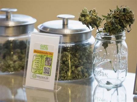 """Jars of marijuana strain """"Beast Mode OG"""" are pictured in Johnson's Queen Anne Cannabis Club in Seattle, Washington"""