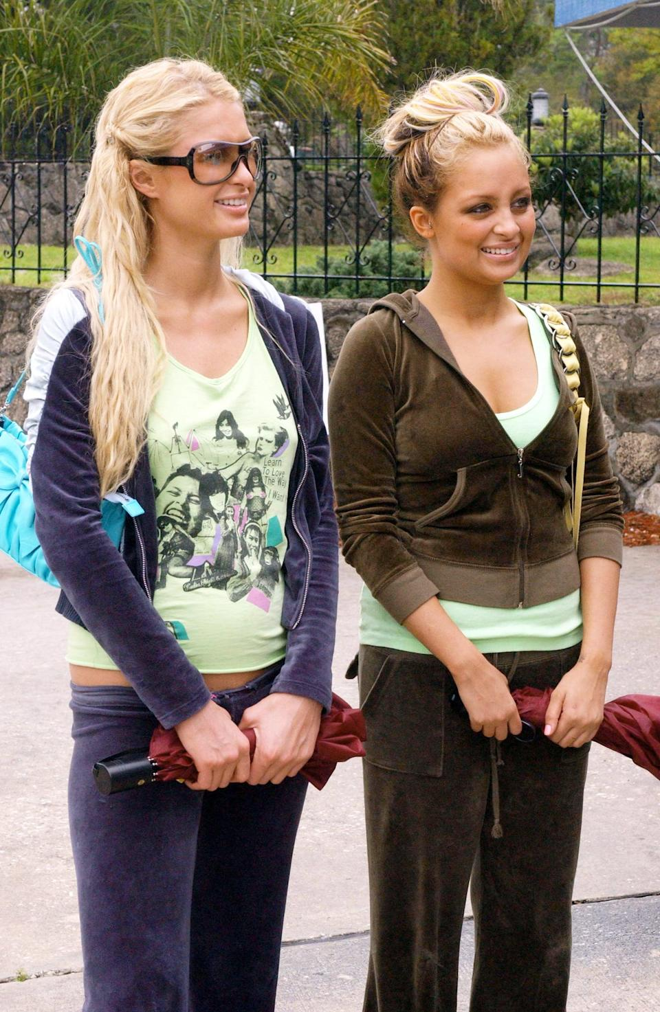 <p>How cute are their matching Juicy tracksuits?</p>