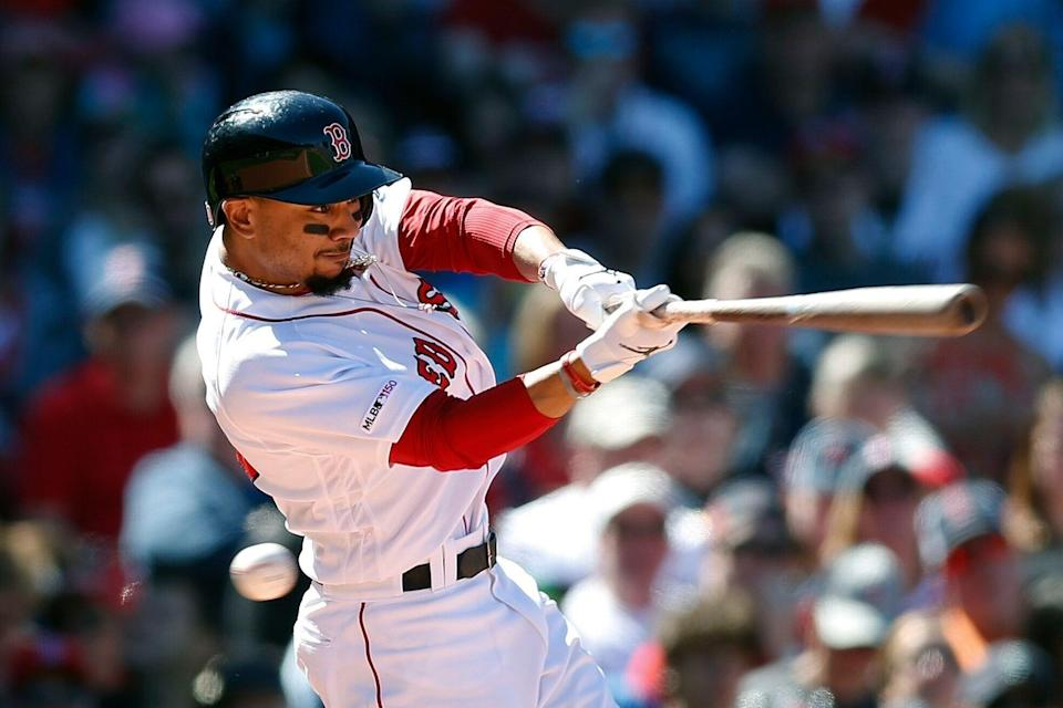 Boston Red Sox's Mookie Betts swings for a strike during the fifth inning of a baseball game against the Seattle Mariners in Boston, Saturday, May 11, 2019. (AP Photo/Michael Dwyer)