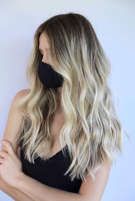 "Again, color that grows out easily seems to be this year's top trend. One of the best ways to do this is with a blurred root, which Tardo calls a 2020 remix of ombré. ""Muting your hair color near at your roots helps to alleviate high-maintenance hair color by creating a more blended grow out,"" he says. ""Touch-ups are only needed twice a year, and the look maintains an intentional and fresh feel."" To get the look, ask your colorist for a shadow root and have them fade it down into your hair."