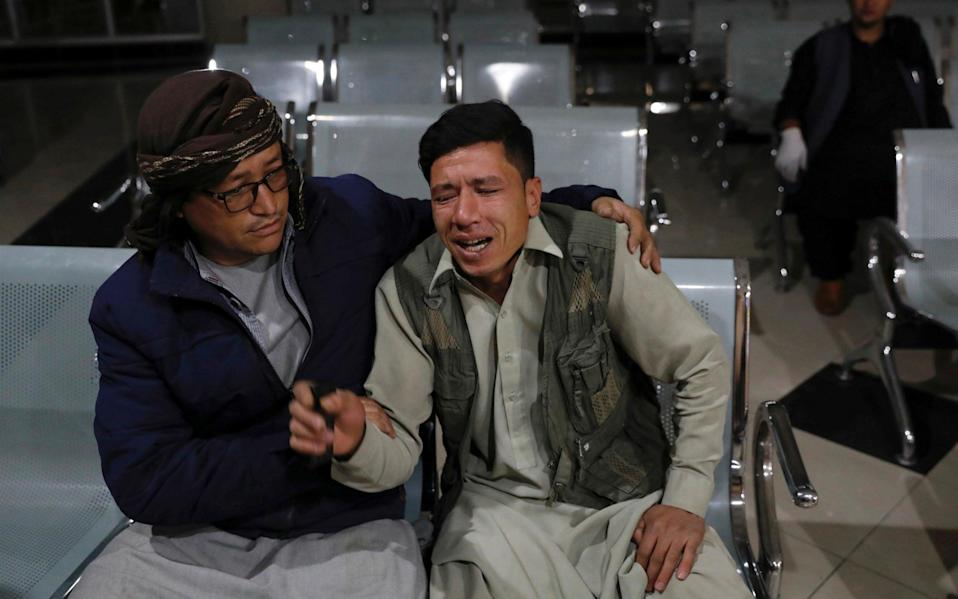 Man who lost his brother mourns at a hospital after a suicide bombing in Kabul - REUTERS