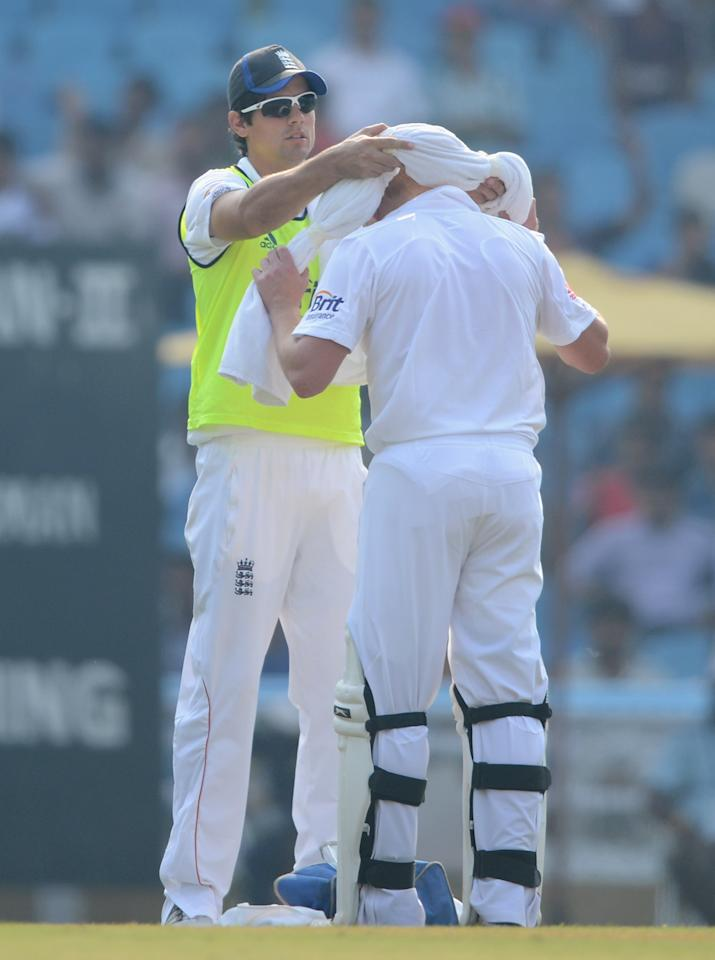 England 12th man Alastair Cook with Jonathan Bairstow during day one of the tour match between Mumbai A and England at The Dr D.Y. Palit Sports Stadium on November 3, 2012 in Mumbai, India. (Photo by Gareth Copley/Getty Images)