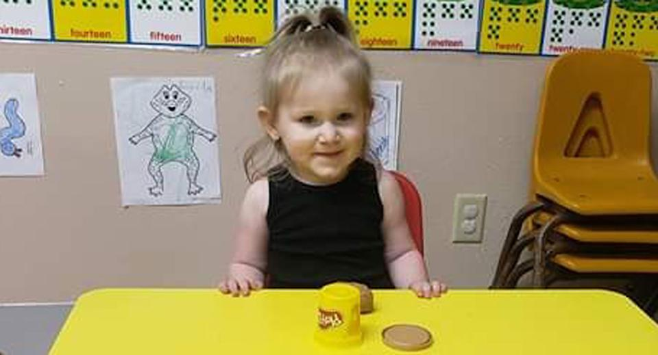 Pictured is Zariah Hasheme, 2, at a desk at daycare.