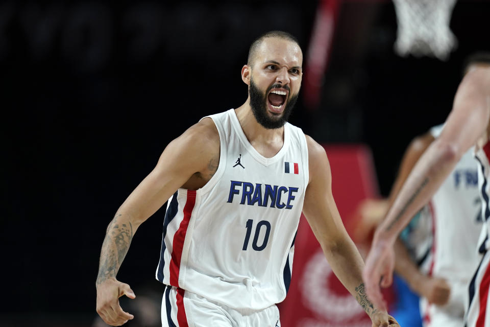France's Evan Fournier (10) celebrates after making a 3-point basket during a men's basketball semifinal round game against Slovenia at the 2020 Summer Olympics, Thursday, Aug. 5, 2021, in Saitama, Japan. (AP Photo/Charlie Neibergall)