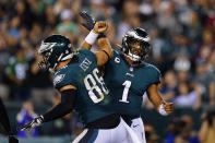 Philadelphia Eagles quarterback Jalen Hurts (1) celebrates his touchdown with Philadelphia Eagles tight end Zach Ertz (86) during the second half of an NFL football game against the Tampa Bay Buccaneers on Thursday, Oct. 14, 2021, in Philadelphia. (AP Photo/Matt Rourke)
