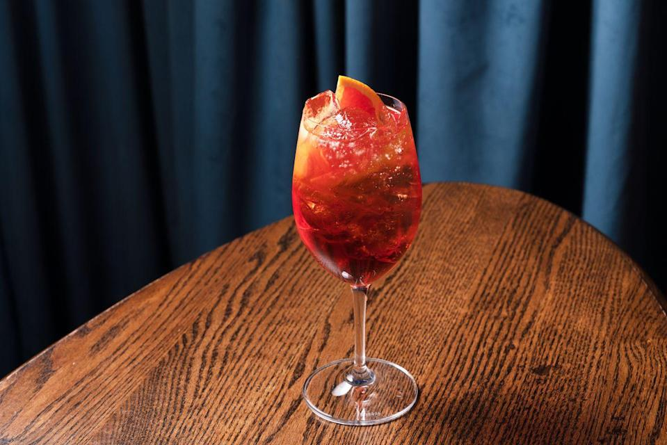 """<p>This beautiful libation was created by the bar team behind <a href=""""https://www.viamarenantucket.com/"""" rel=""""nofollow noopener"""" target=""""_blank"""" data-ylk=""""slk:Via Mare"""" class=""""link rapid-noclick-resp"""">Via Mare</a> at the Roman & Williams-designed <a href=""""https://greydonhouse.com/"""" rel=""""nofollow noopener"""" target=""""_blank"""" data-ylk=""""slk:Greydon House"""" class=""""link rapid-noclick-resp"""">Greydon House</a> in Nantucket. It's the perfect drink to sip on a sunny patio in one of our favorite destinations.</p><p><strong>Ingredients:</strong><br></p><p>1.5 ounces Cocchi Americano Rosa</p><p>1 oz Braulio Alpine Amaro</p><p>1 dash Bitterman's Burlesque Bitters</p><p>Prosecco </p><p>Orange twist, for garnish</p><p><strong>Directions:</strong></p><p>Combine all of the ingredients, except for Prosecco, in a highball or wine glass with ice and stir to chill. Top with Prosecco and garnish with orange twist.</p>"""