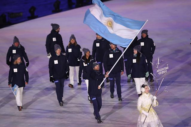 <p>Flag bearer Sebastiano Gastaldi of Argentina leads the team during the Opening Ceremony of the PyeongChang 2018 Winter Olympic Games at PyeongChang Olympic Stadium on February 9, 2018 in Pyeongchang-gun, South Korea. (Photo by Ronald Martinez/Getty Images) </p>