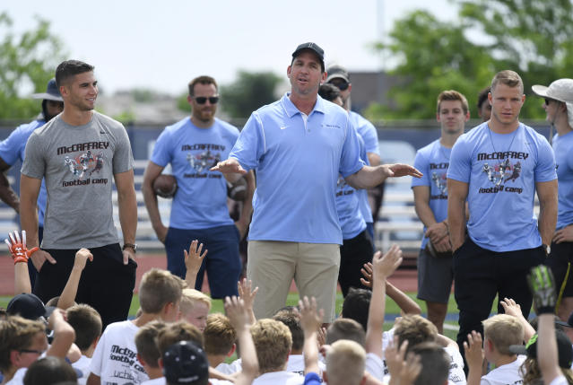 """Former <a class=""""link rapid-noclick-resp"""" href=""""/nfl/teams/denver/"""" data-ylk=""""slk:Denver Broncos"""">Denver Broncos</a> WR Ed McCaffrey will move from coaching high school football to coaching college football. (Photo by Andy Cross/MediaNews Group/The Denver Post via Getty Images)"""