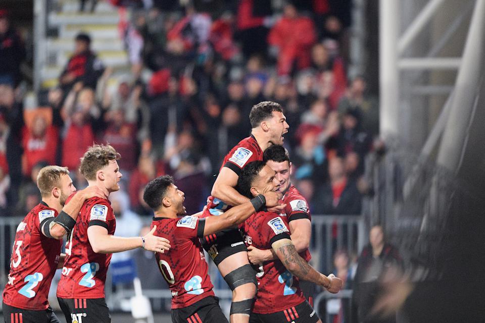 Braydon Ennor, Mitchell Drummond, Richie Mo'unga, David Havili and Sione Havili congratuate Will Jordan of the Crusaders (L-R) all celebrate after scoring a try.