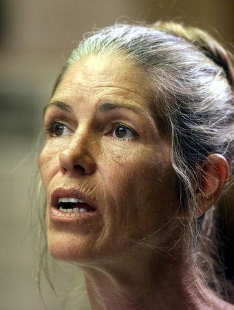 FILE PHOTO - Leslie Van Houten listens during her parole hearing in Corona, California, U.S. on June 28, 2002. REUTERS/DamianDovarganes/Pool/File Photo
