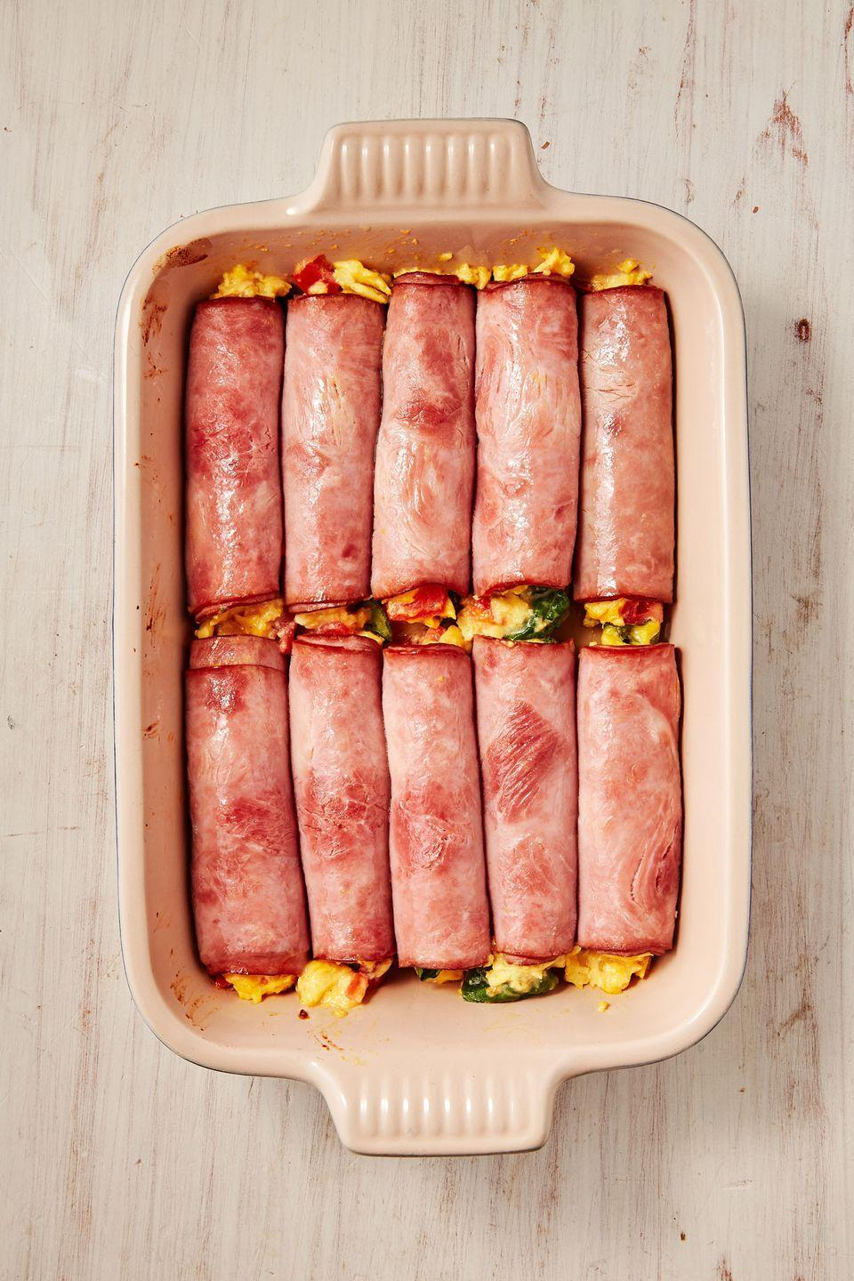 "<p>Who needs a tortilla when you have ham?</p><p>Get the recipe from <a href=""https://www.delish.com/cooking/recipe-ideas/recipes/a51155/ham-egg-cheese-roll-ups-recipe/"" rel=""nofollow noopener"" target=""_blank"" data-ylk=""slk:Delish"" class=""link rapid-noclick-resp"">Delish</a>.</p>"