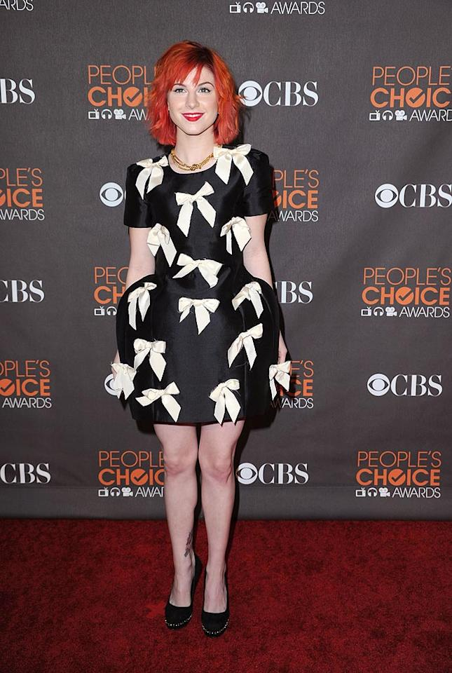 "Paramore lead singer Hayley Williams paired her fiery red locks with a voluminous, bow-adorned Luella frock. Hot or not? Steve Granitz/<a href=""http://www.wireimage.com"" target=""new"">WireImage.com</a> - January 6, 2010"