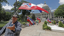 """""""I love this flag,"""" states David Flynt of Hattiesburg, while standing outside the state Capitol with other current Mississippi flag supporters in Jackson, Miss., Sunday, June 28, 2020. Lawmakers in both chambers are expected to debate state flag change legislation today. Mississippi Governor Tate Reeves has already said he would sign whatever flag bill the Legislature decides on. (AP Photo/Rogelio V. Solis)"""