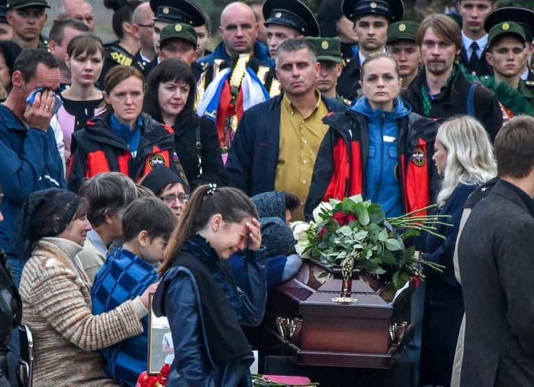 Mourners attended a funeral ceremony for the victims of the school shooting in the Russian-annexed Crimea city of Kerch