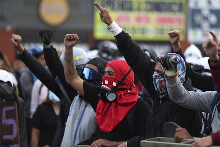 Protesters shout slogans during an anti-government protest in Bogota, Colombia, Monday, May 10, 2021. Colombians have protested across the country against a government they feel has long ignored their needs, allowed corruption to run rampant and is so out of touch that it proposed tax increases during the coronavirus pandemic. (AP Photo/Fernando Vergara)