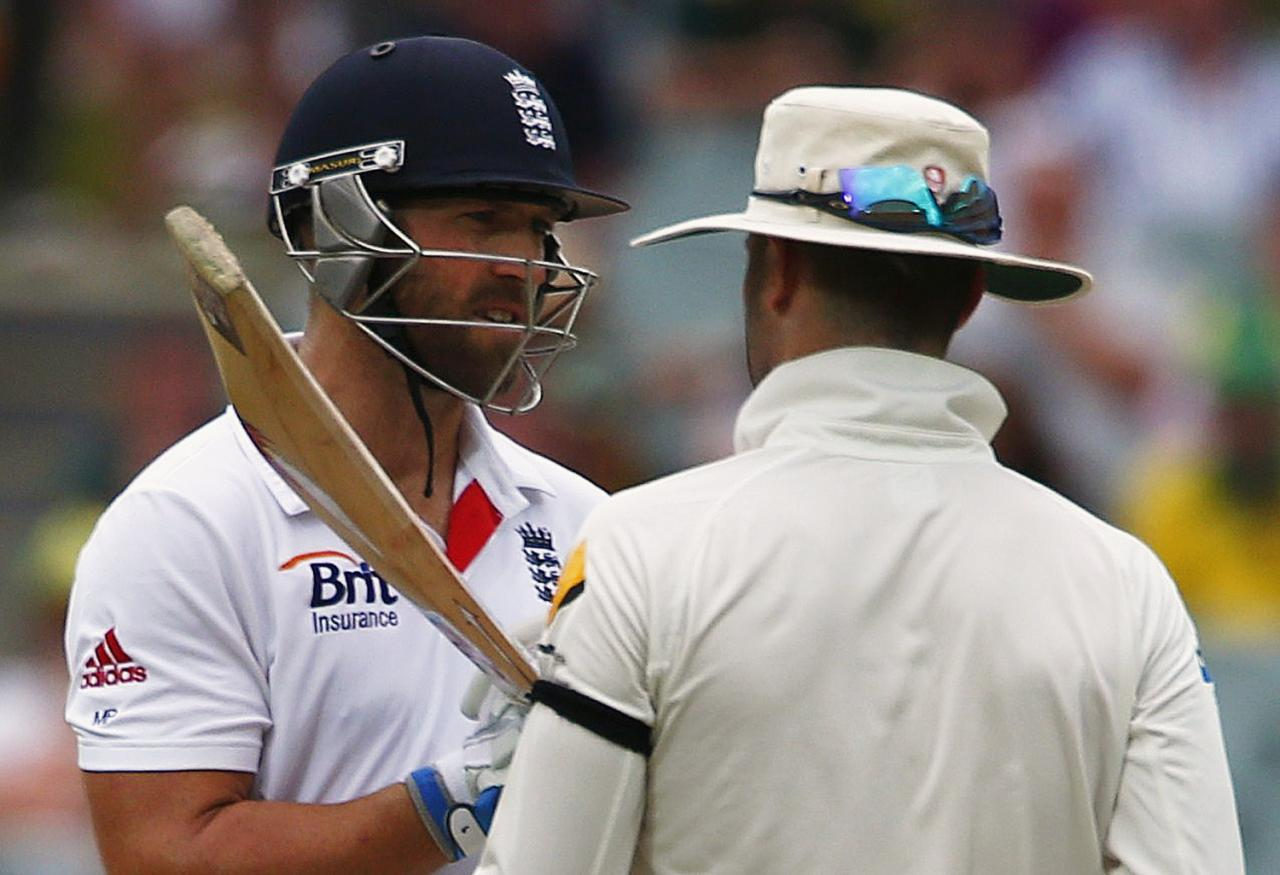 England's Matt Prior (L) argues with Australia's captain Michael Clarke during the fourth day's play in the second Ashes cricket test at the Adelaide Oval December 8, 2013. REUTERS/David Gray (AUSTRALIA - Tags: SPORT CRICKET)