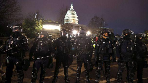 PHOTO: Police officers in riot gear line up as protesters gather on the U.S. Capitol Building, Jan. 6, 2021, in Washington, D.C. (Tasos Katopodis/Getty Images)