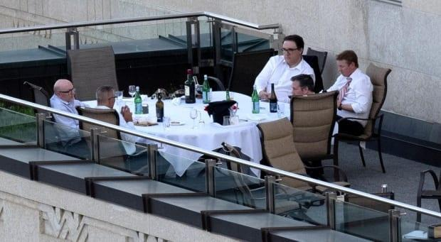 Premier Jason Kenney, Environment and Parks Minister Jason Nixon, Finance Minister Travis Toews, Health Minister Tyler Shandro and a staff member were photographed without their knowledge while dining outdoors on a terrace of a building at the Alberta legislature grounds in Edmonton on June 1.  (Submitted - image credit)