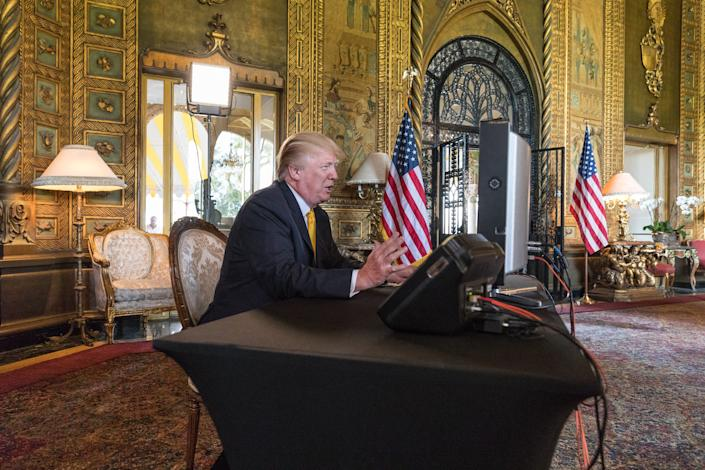 President Donald Trump speaks with members of the armed forces via video conference from the living room of Mar-a-Lago, on Thanksgiving in Palm Beach, November 23, 2017. (Greg Lovett / The Palm Beach Post)