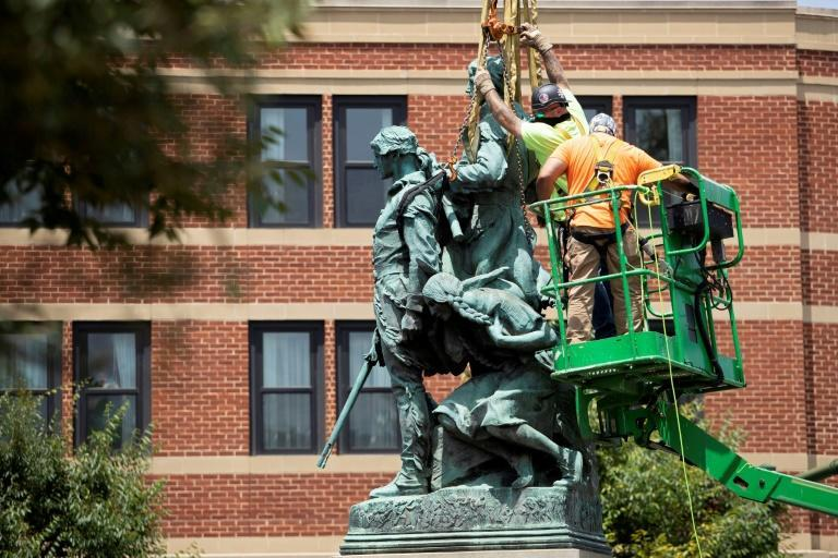 A statue of Meriwether Lewis, William Clark and Sacagawea is removed from Charlottesville, Virginia on July 10, 2021
