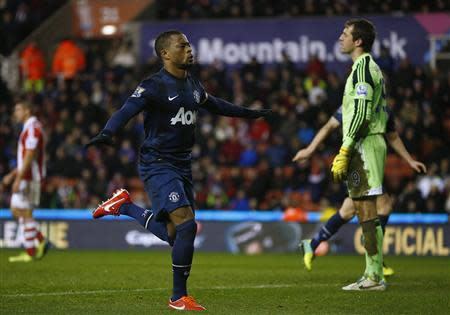 Manchester United's Patrice Evra celebrates scoring during their English League Cup quarter-final soccer match against Stoke City at the Britannia stadium in Stoke-on-Trent, central England, December 18, 2013. REUTERS/Darren Staples