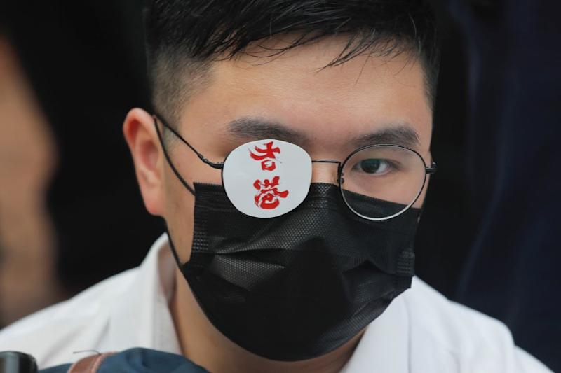 """A secondary student covers one eye reading """"Hong Kong"""" in memory of a woman injured in an earlier pro-democracy protest in Hong Kong, on Monday, Sept. 2, 2019."""