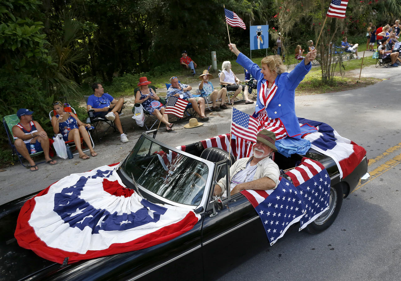 "<p>Decked out in full American flag decor this ""float"" makes its way down Tuscawilla Road during the annual Fourth of July Parade, in Micanopy, Fla., Tuesday, July 4, 2017. (Photo: Brad McClenny/The Gainesville Sun via AP) </p>"