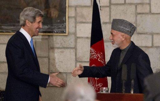 US Secretary of State John Kerry (L) and Afghanistan's President Hamid Karzai shake hands at the end of their press conference at the Presidential Palace in Kabul on March 25, 2013. Kerry made an unannounced visit to Kabul on Monday and vowed to stick by Afghanistan despite Karzai's hostility to US-led military efforts in the country